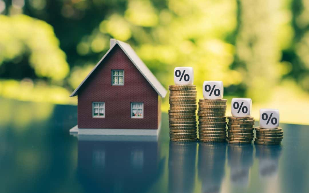 Mortgage rates decline this week house with tiered stack of money representing percentage