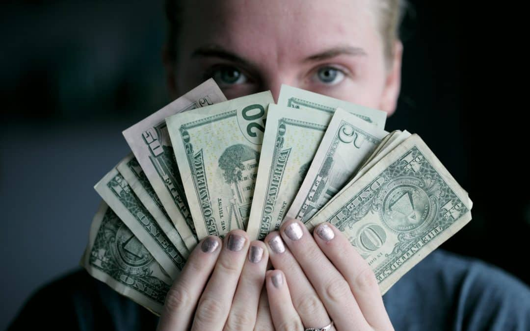Person Holding Money US Dollars