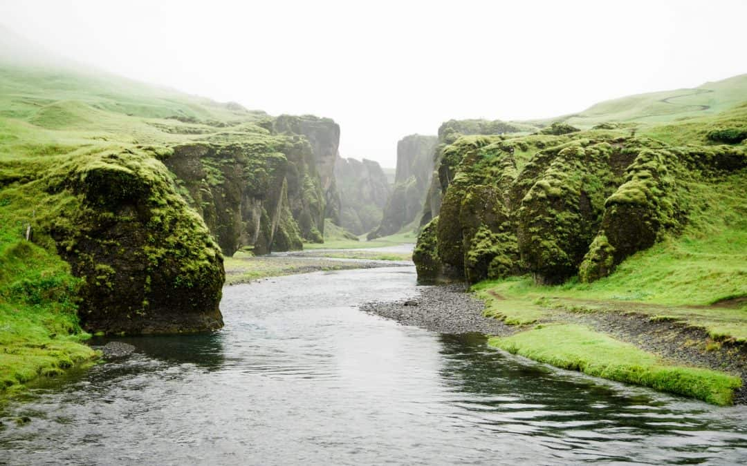 River In Middle Of Cliffs