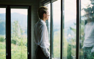 Man Pondering Looking Out Window