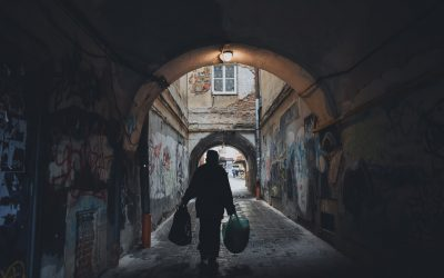 Person Carrying Bag in an Alley