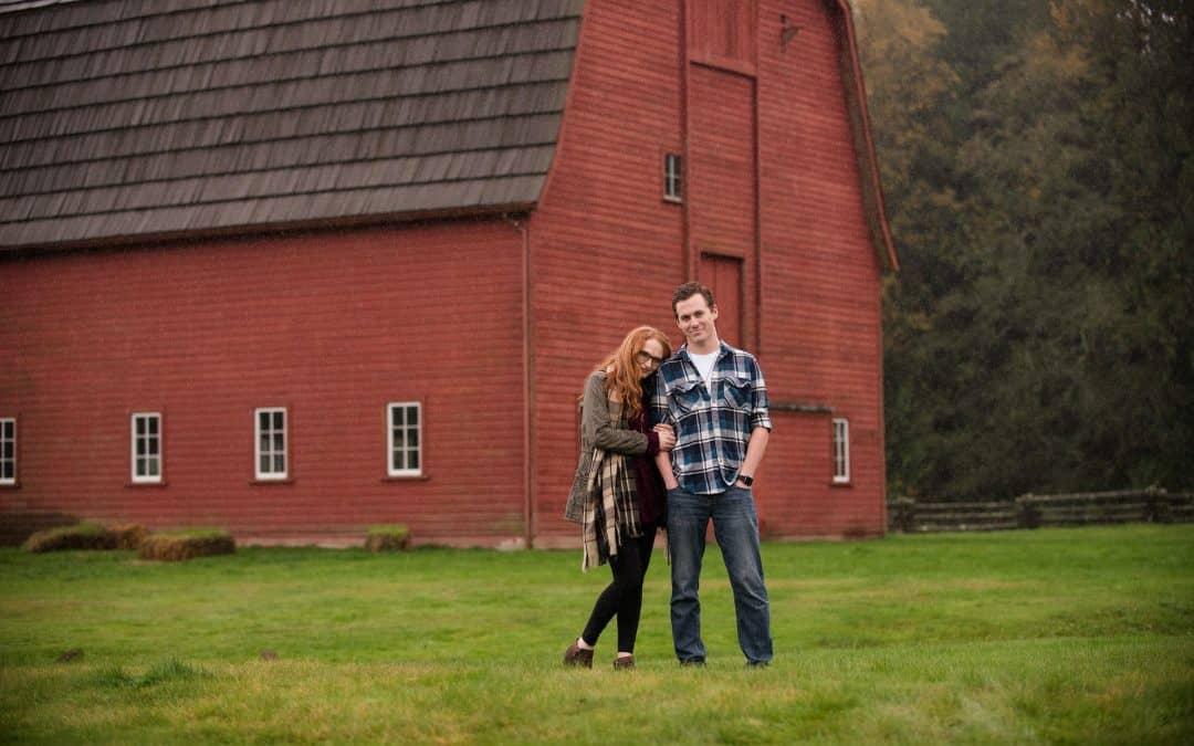 Couple in Front of Barn Home Barndominium