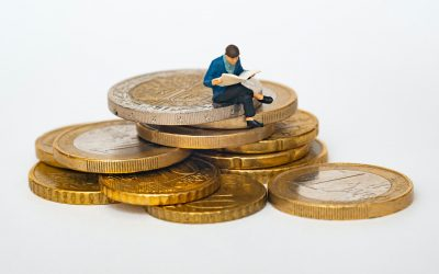 Person Sitting on Coins Reading