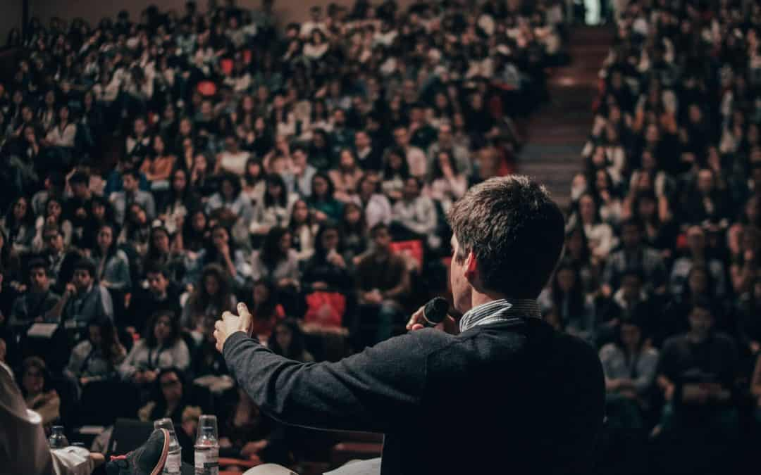 Person Speaking to a Crowd